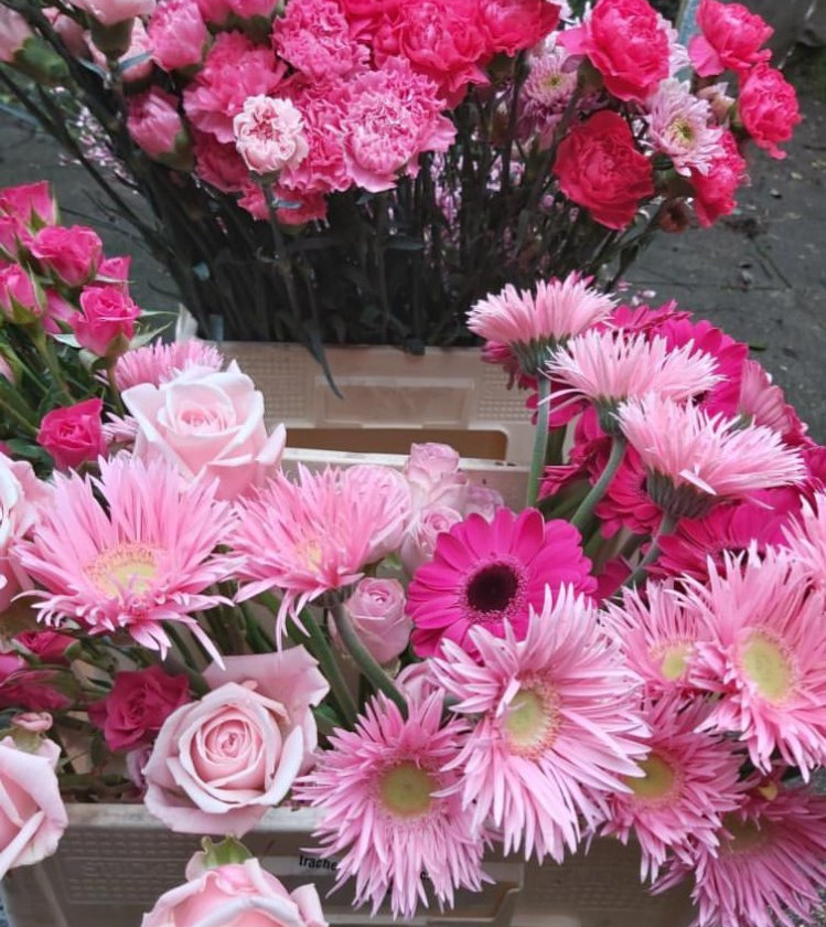 Pink roses, pink gerbera and pink carnations used in a floral foam free flower arranagement and floral installation by emma jane foral design.