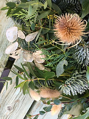 Close up of fresh christmas wreath with dried elements of teasles, lunaria and bunny tail grasses by Emma Jane Floral Design