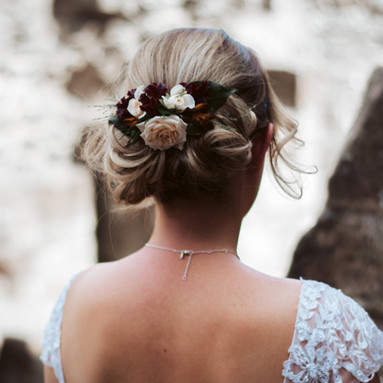 A floral hair piece for the happy bride by Emma Jane Floral Design