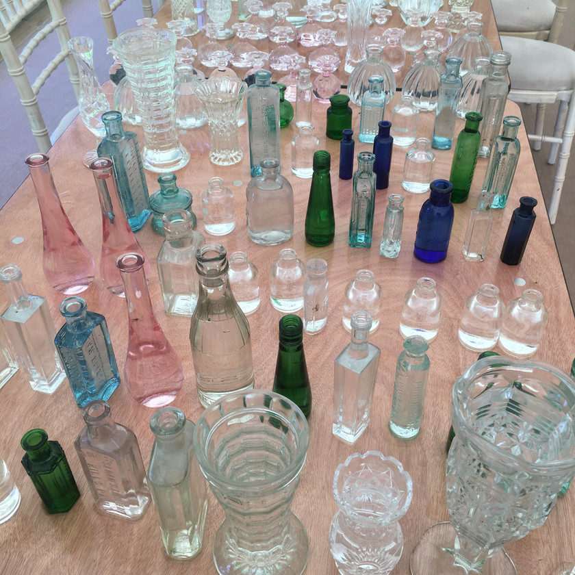 Emma Jane Floral Design a selection of vases in different colours laid out on a table