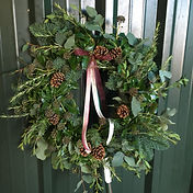 Luxury mixed foliage wreath with pinecones and trailing ribbon by Emma Jane Floral Design