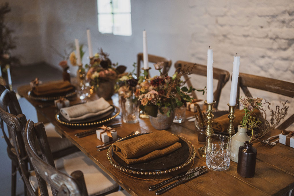 Tablescape with compote centrepieces and bud vases by Emma Jane Floral Design