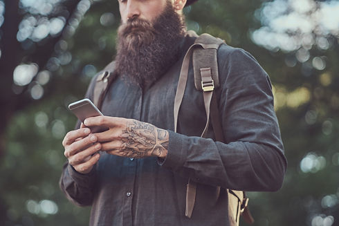 A handsome hipster traveler with a styli