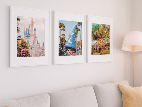mockup-of-three-poster-frames-hanging-on