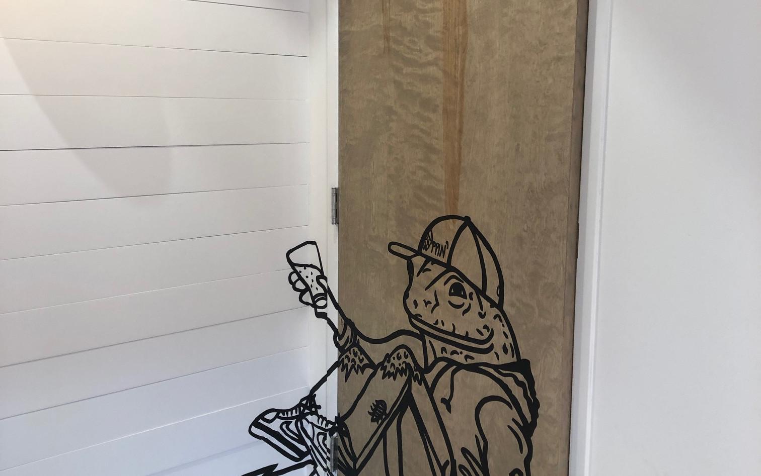 Hoppin' Frog on Male Bathroom Door