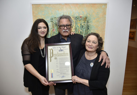 Satish with daughter Amanda (left) and wife Terry (right) with Proclamation from the City of Yonkers