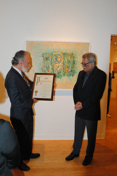"""Satsih Joshi being presented with a Proclamation from past City Councilman Michael Sabatino on behalf of the City of Yonkers stating March 13th will now be """"Satish Joshi Day"""""""
