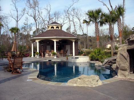 Freeform Pool with Rock Slide and Pavili