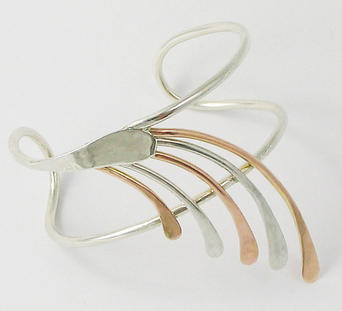 A006: 9ct Red Gold and Silver Fantail Bangle.