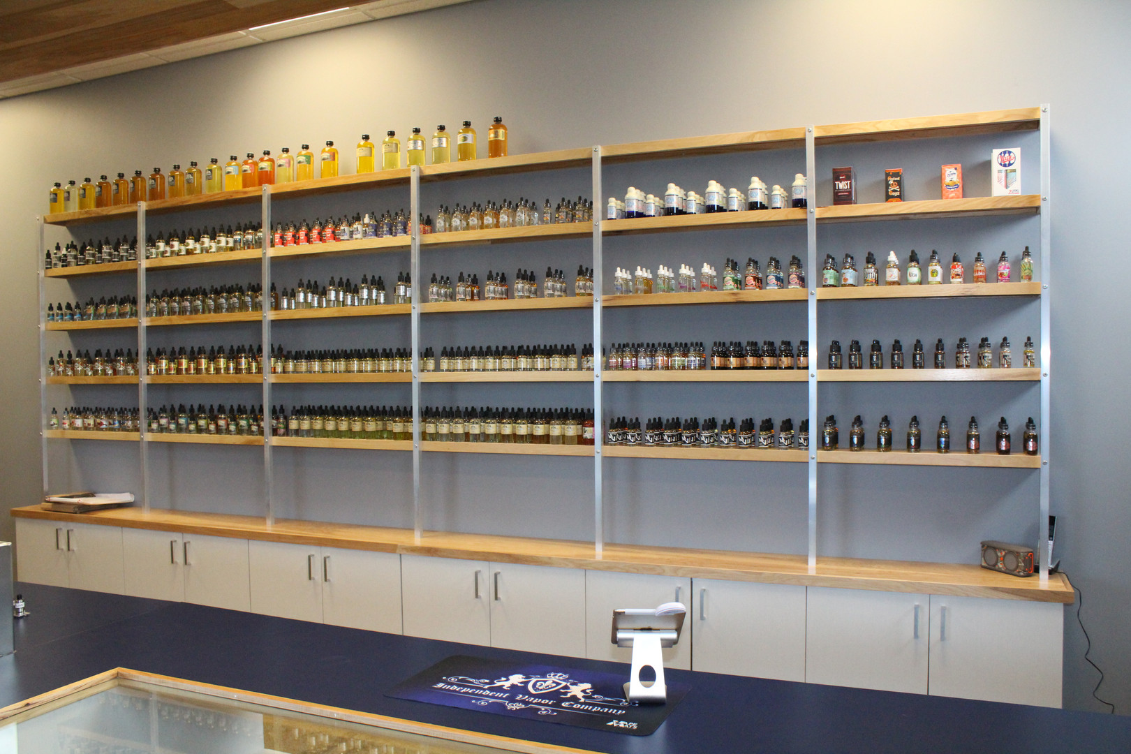 Independent Vapor Display Shelves and Cabinets