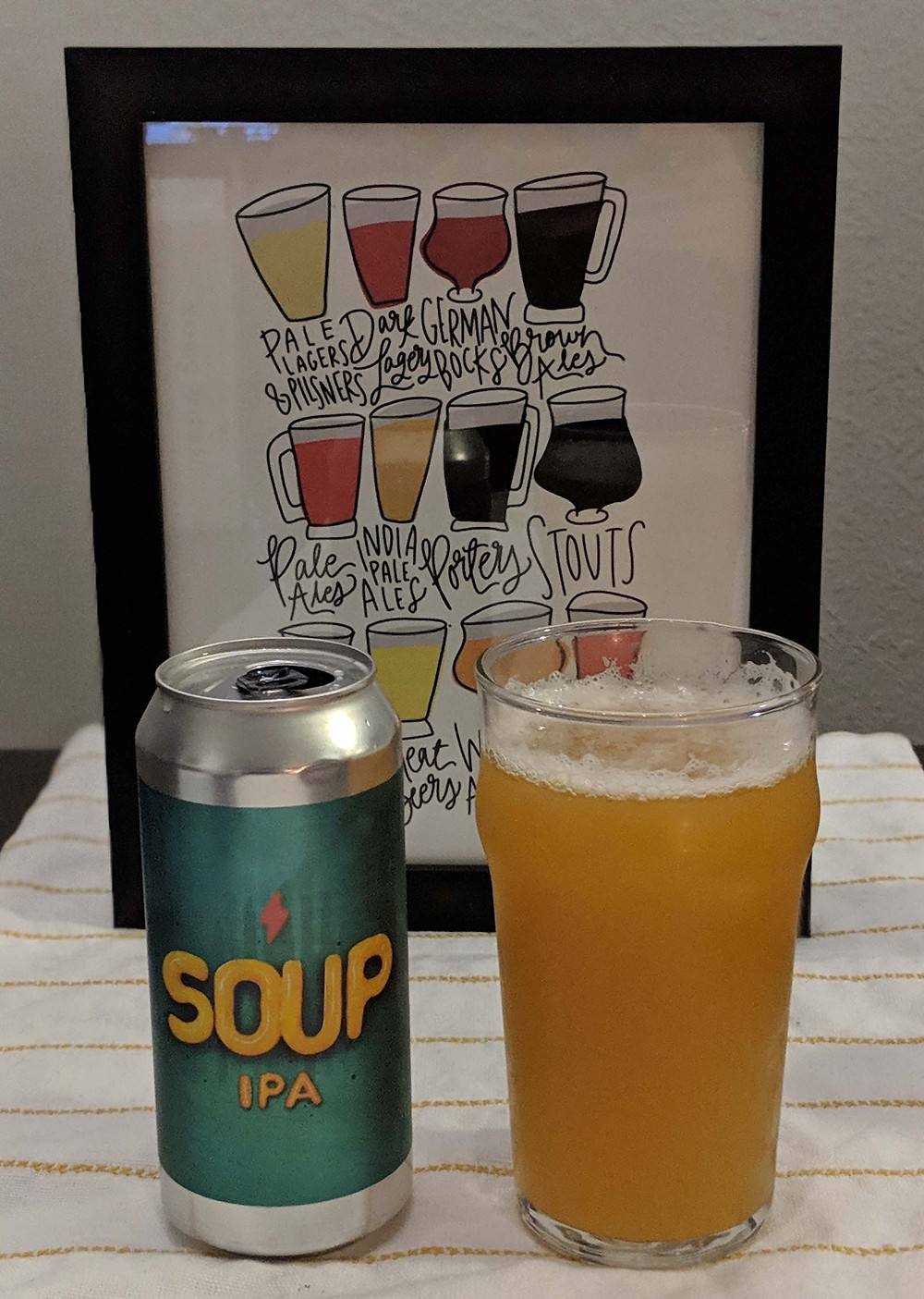 Soup IPA can next to beer glass