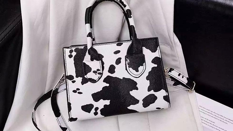 Mini cow print shoulder bag