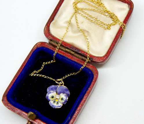 Enamel pansy pendant with diamond pendant which such detailed enamelling you would be excused for mistaking it for the real thing the word pansy comes from the french pense meaning aloadofball