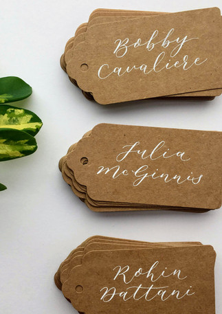 white-caligraphy-kraft-brown-place-cards