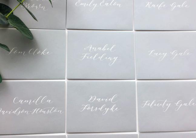 escort-card-envelopes-grey-calligraphy