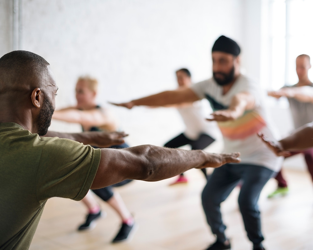 Group of people being lead in a group workout