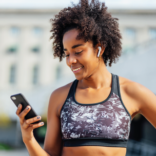 Women exercising and using phone to track