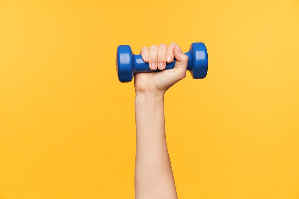 Arm-raised-holding-dumbell