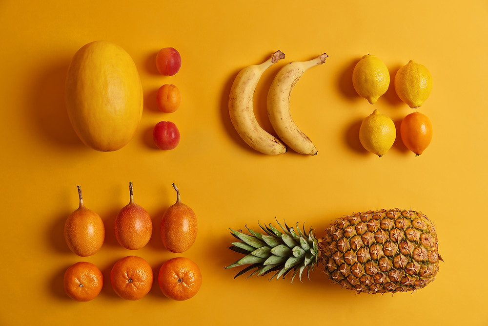 Different types of fruit on a yellow background