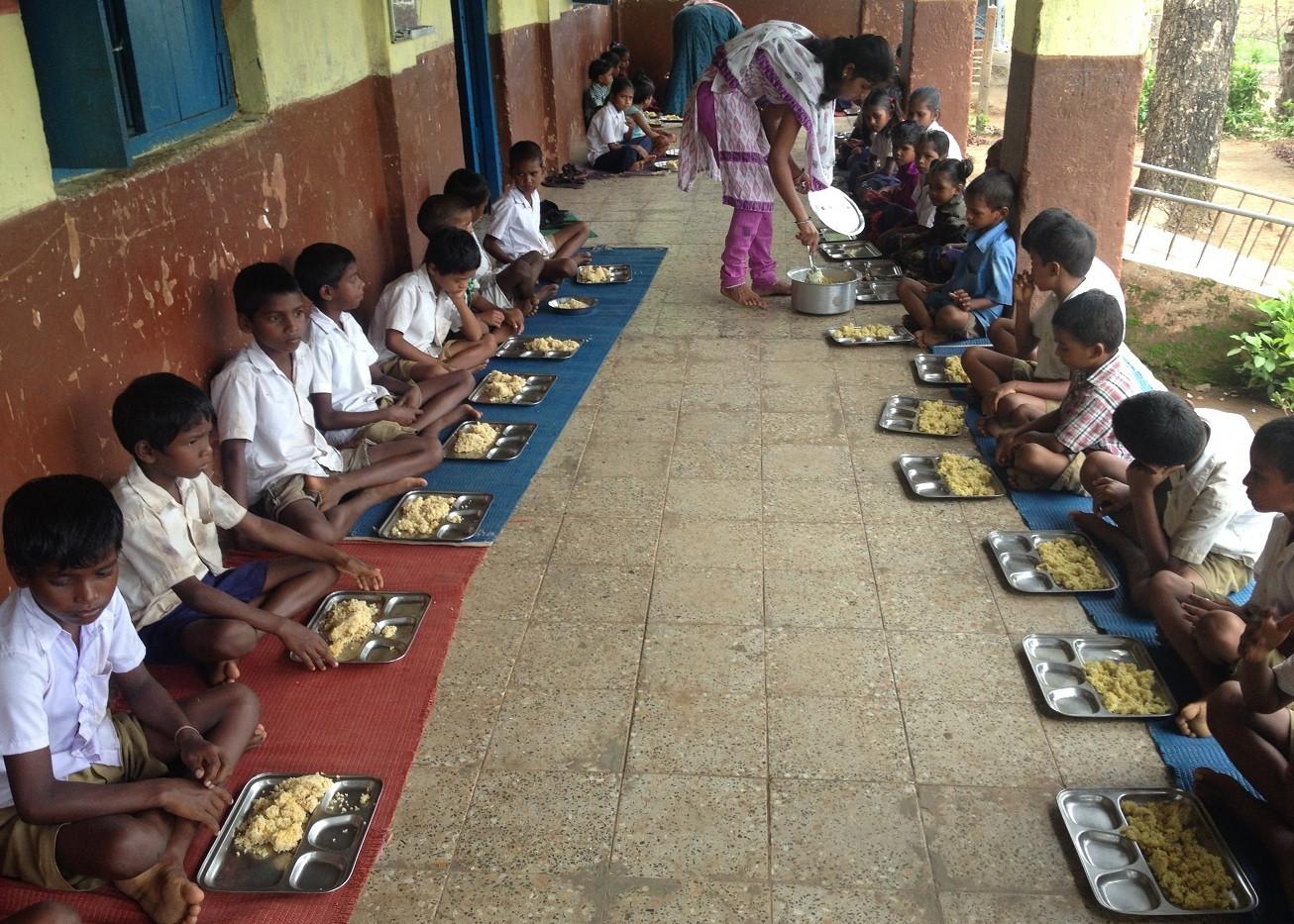 Teacher Bebi serving her happy students