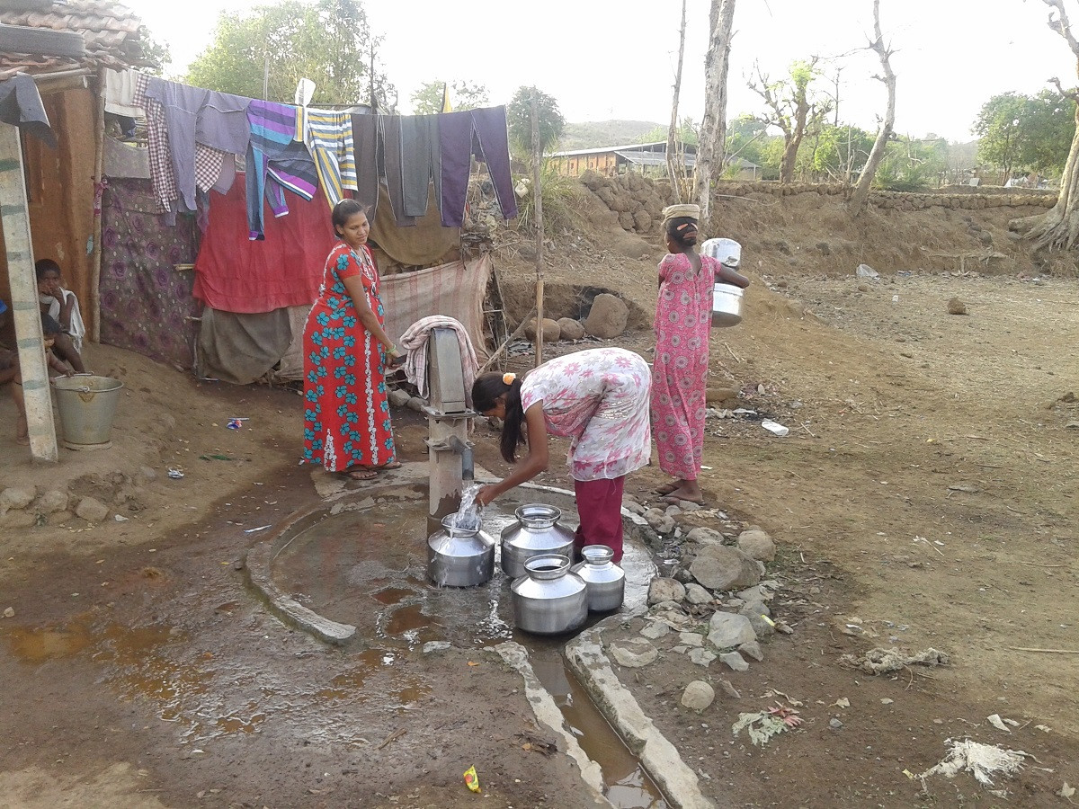 women filing water in bendgaon village.j