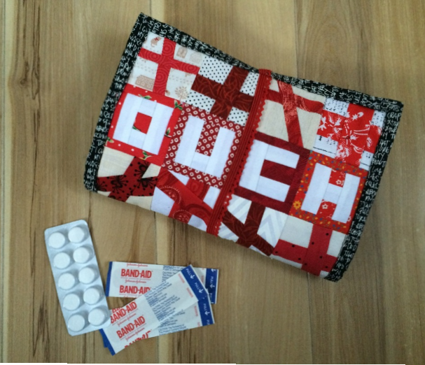Ouch First Aid Kit by Lara Motta