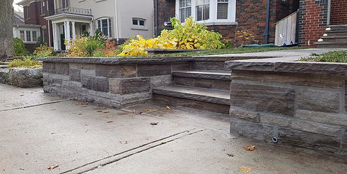 Stone retaining wall and pathway designed by Leaside Landscaping