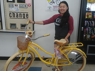 Amy C winner of bike at walnut grove coin laundry