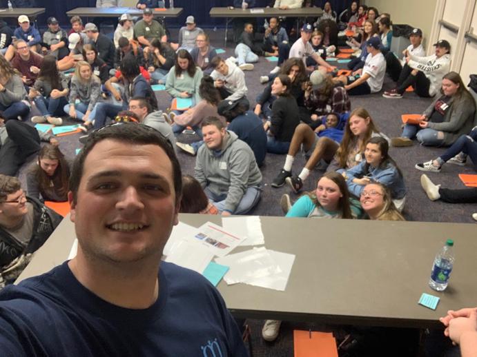 Brooks Medford selfie with seniors at Finance 101