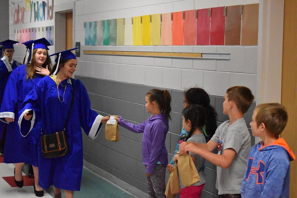R-S Central seniors walk the halls at Pinnacle Elementary