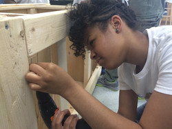 Students building a mobile kitchen