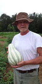 Farmer Charlie with a Kushaw squash