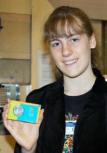 Girl holding coin