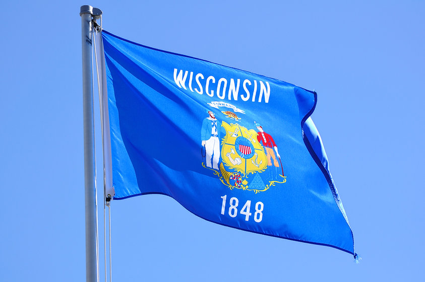 Wisconsin State Flag Against a Blue SKy.