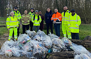 Some of the volunteers from the M6 Junction 10 scheme, teachers and community officers who cleaned up the play area