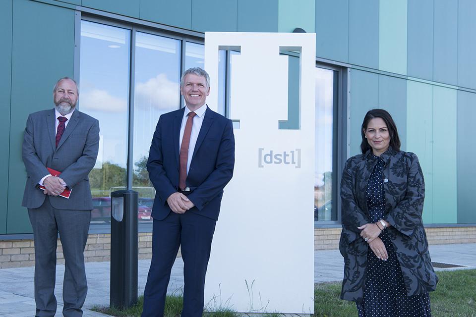 Dstl's Mike Smith CTS Lead, Dstl's Chief Executive Gary Aitkenhead and Home Secretary Priti Patel