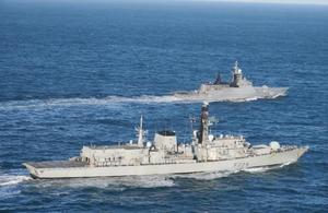 HMS Lancaster (foregrounds) shadows Steregushchiy-class corvette Boikiy