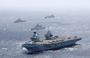 HMS Queen Elizabeth of UK Carrier Strike Group in company with an Indian Shivalik Multi-role Frigate during Maritime Partnership Exercises in the Bay of Bengal