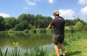 Angler fly fishing