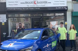 Tommy Sandhuand students enjoying using an electric vehicle funded by Highways England