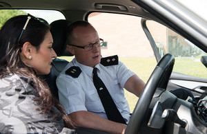 Home Secretary Priti Patel looks at the latest research for police vehicles at Dstl's Head Quarters