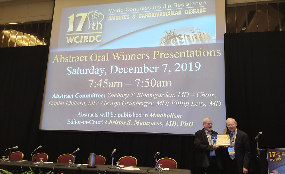 Concenter BioPharma cofounder and CSO Prof. Mottie Chevion, left, receiving his award from Dr. Zachary Bloomgarden at the World Congress on Insulin Resistance, Diabetes and Cardiovascular Diseases in Los Angeles, December 2019. Photo: courtesy