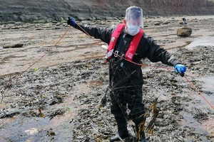 An Environment Agency fisheries officer seizes the illegal fishing net at Skinningrove