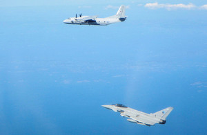 RAF Typhoon (bottom) deployed on Operation AZOTIZE in Estonia intercepts a Russian military transport aircraft (top)