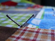 tying-a-quilt-300x225.jpg