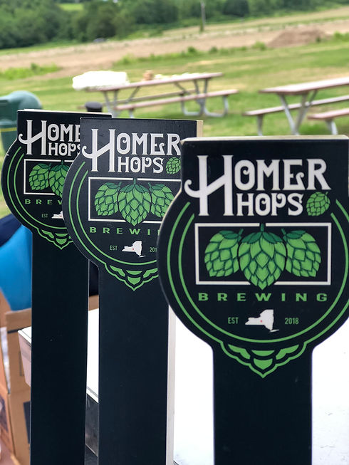 Three Homer Hops Brewing tap handles