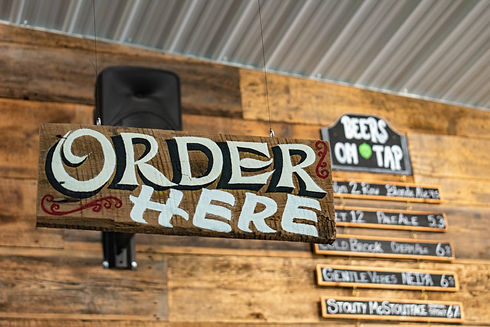 Order here sign at a brewery