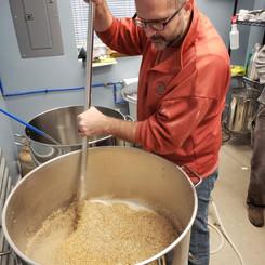 Man mixing beer ingredients