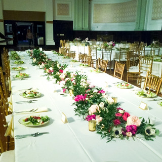 Large Head Table with Greenery and Florals