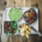 Avocado Bacon and Angus Beef Burger served with Salad and Fries